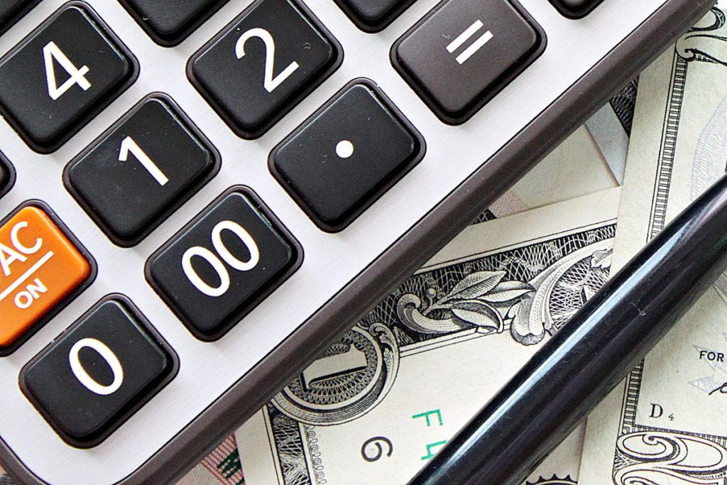 Calculator, pen and money